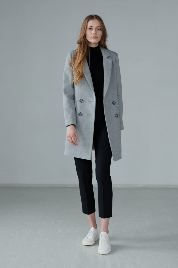 Classic double-breasted light gray coat, pocket in the seam with decorative flaps.