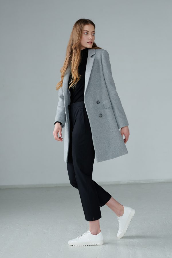 A gray, double-breasted, short women's coat with a timeless cut, stylish and functional, complementing many styles.