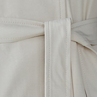 trench coat fabric in the color of cool cream It is a tone of cream color